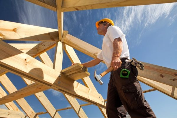 carpenter or roofer checking roof construction
