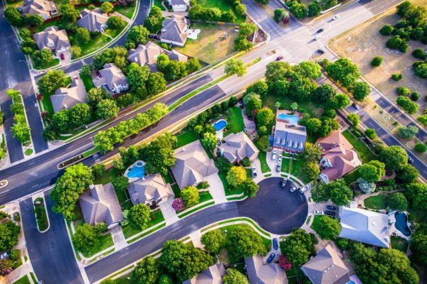 Vast Homes and Thousands of Houses Modern Suburb Development - aerial drone view looking straight down from above Intersection at Road and Urban Modern Suburb houses and homes colorful rooftops representing South Tampa Home Features