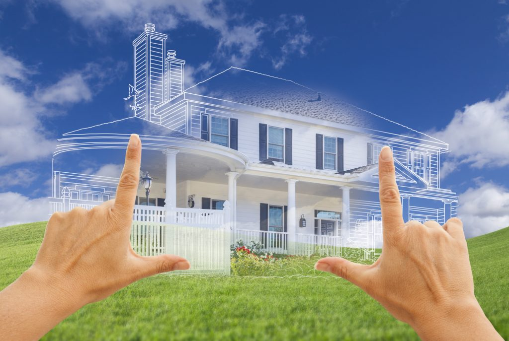 Female Hands Framing Beautiful Custom House Drawing and Ghosted House Above Grass Field.