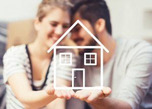 Young couple holding their new home icon